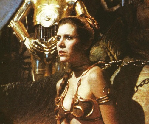 Princess Leia Organa Solo Skywalker wallpaper probably with a bandsman and a concert called Slave Leia