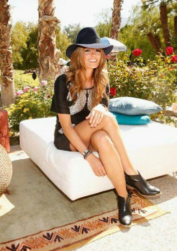 Stana Katic achtergrond with bare legs, hosiery, and a hip boot titled Stana Katic at Coachella 2013