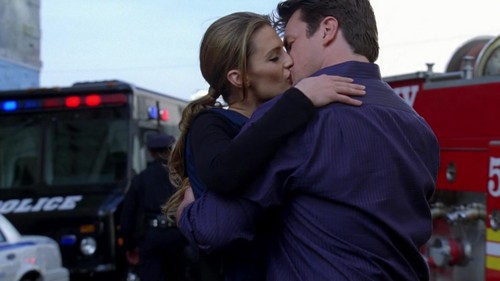 Caskett wallpaper probably with a business suit and a street entitled Caskett 5x22 Screencaps