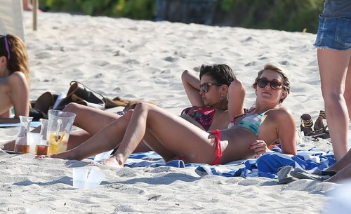 Nina Dobrev wallpaper with a bikini titled Julianne Hough and Nina Dobrev hanging out with friends on the beach in Miami