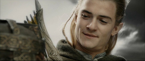 Legolas Greenleaf wallpaper possibly with a hood titled Legolas in RotK