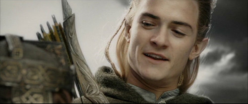 Legolas Greenleaf wallpaper probably with an outerwear, a fur coat, and a box coat entitled Legolas in RotK