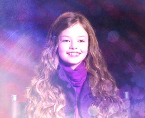 renesmee carlie cullen wallpaper probably with an outerwear, a well dressed person, and a portrait titled Mackenzie Foy