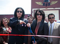 ★ Paul Stanley and Gene Simmons hosted  an opening in Torrance, they served 100 military veterans - kiss photo