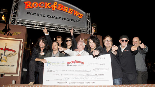 ★ Paul Stanley and Gene Simmons hosted an opening in Torrance, they served 100 military veterans