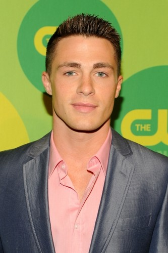 Colton Haynes wallpaper containing a business suit, a suit, and a three piece suit titled CW Upfront Event in NYC