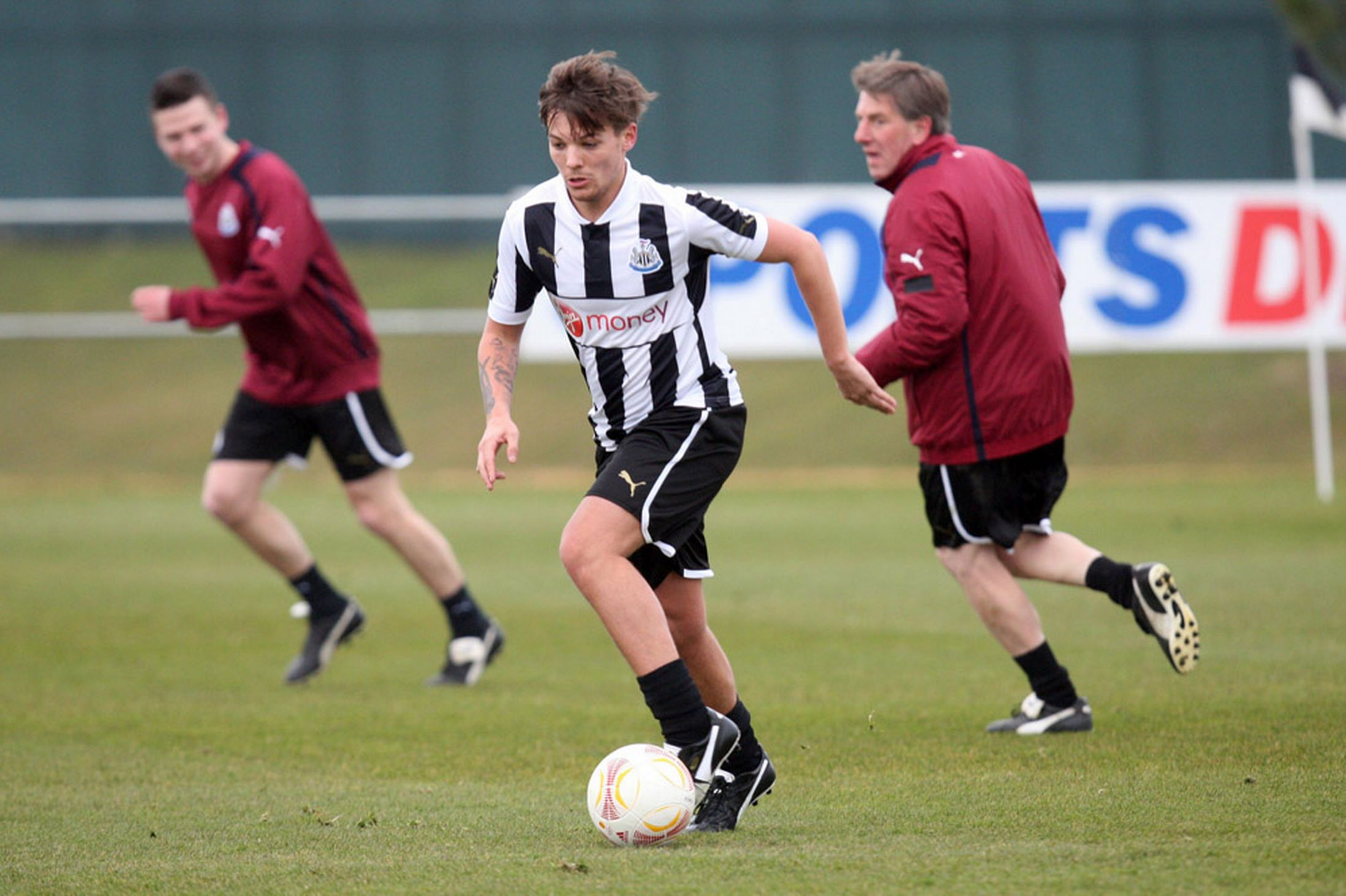 Louis playing football <3