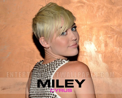 Miley Cyrus wallpaper probably containing a portrait called Miley Cyrus