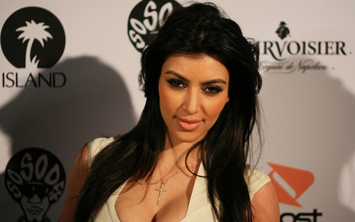 Kim Kardashian wallpaper containing a portrait and attractiveness called  Kim Kardashian