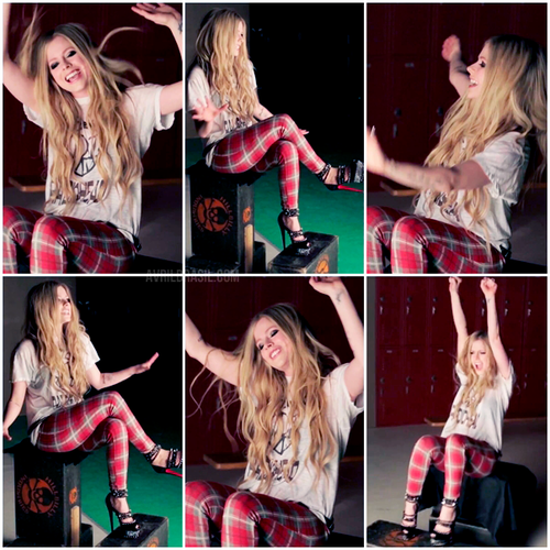 Avril Lavigne achtergrond with a portrait entitled Here's To Never Growing Up