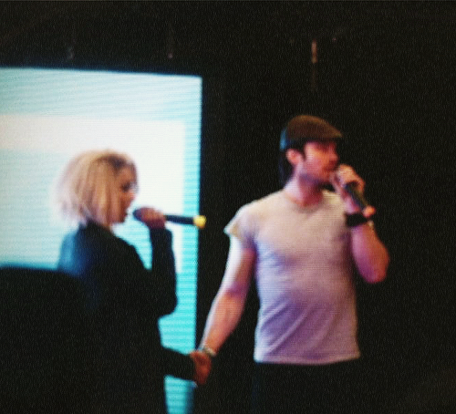 Kat and Ian holding hands at the convention in Paris