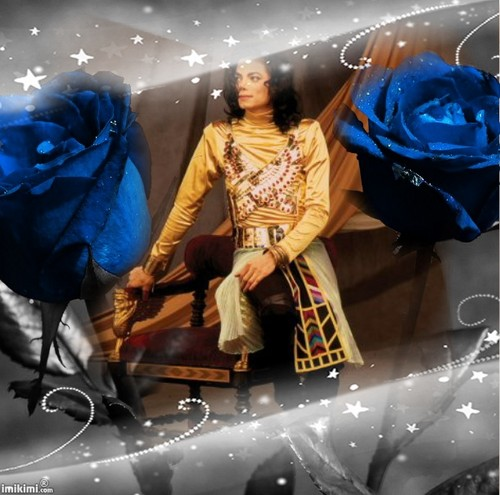 Michael surrounded by beautiful blue roses