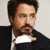 Robert Downey Jr. photo with a business suit, a suit, and a pinstripe titled RDJ