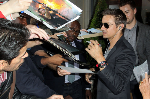 Signing autographs in London