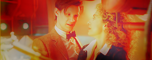 The Doctor and River Song karatasi la kupamba ukuta possibly containing a business suit called Doctor and River