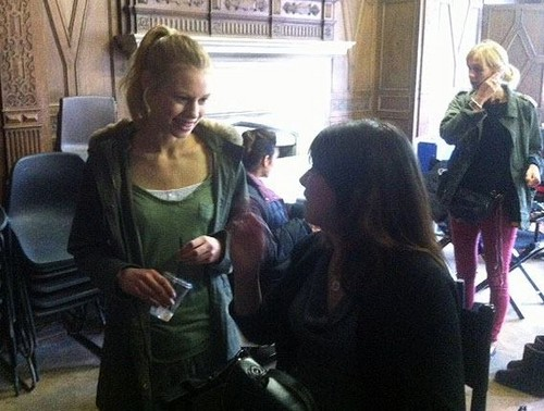 The Vampire Academy Blood Sisters achtergrond possibly with a street, a business suit, and a sign entitled Lucy Fry on set ♥