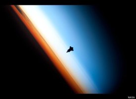 The Silhouette of the Космос Shuttle Endeavour~