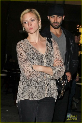 Tyler Hoechlin wallpaper probably with a hip boot, a playsuit, and an outerwear titled ° Tyler Hoechlin ♥ Brittany Snow °