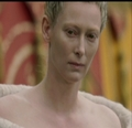 Jadis gives Edmund and Peter a dirty look as she walks by.