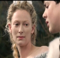 Jadis smiles at Edmund for telling her about Aslans army.