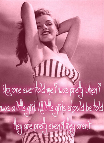 pin up girl wallpaper probably with a bikini, a swimsuit, and skin entitled Marilyn Monroe