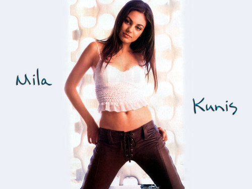 Mila Kunis wallpaper probably containing a legging, a pantleg, and long trousers titled Mila Kunis