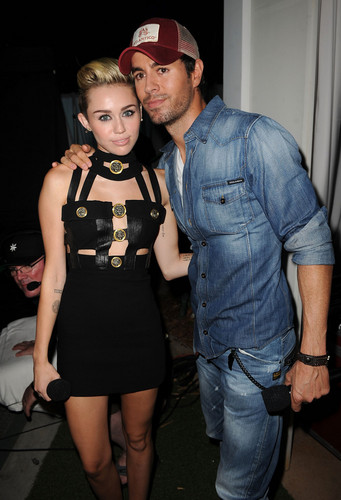 Miley Cyrus and Enrique Iglesias  at the iHeartRadio Ultimate Pool Party
