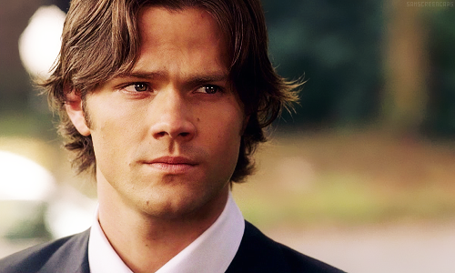 Supernatural wolpeyper with a business suit and a suit titled Sam Winchester