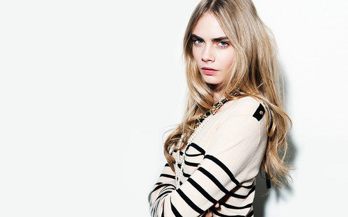 Cara Delevingne karatasi la kupamba ukuta probably containing a top, a playsuit, and a portrait titled cara