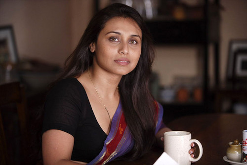 Rani Mukherjee wolpeyper with a coffee break titled rani