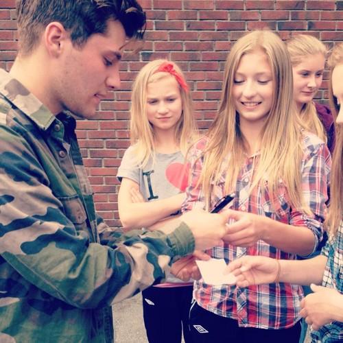 Laurent signing autographs