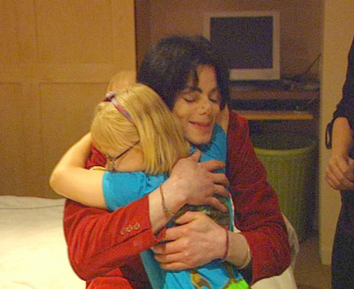 Michael Hugging A Young peminat