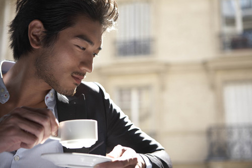 Godfrey Gao achtergrond probably containing a business suit titled G.G.