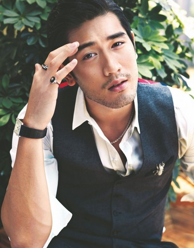 Godfrey Gao achtergrond probably with a business suit entitled G.G.