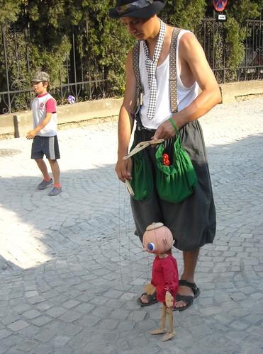 Sighisoara romanian man boy plays with doll Romanians