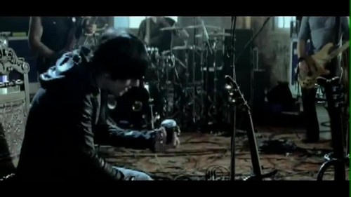 Three Days Grace wallpaper containing a concert entitled Three Days Grace - Pain {Music Video}