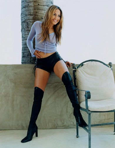 Jennifer Lopez wallpaper probably containing a hip boot and a stocking entitled FHM 1999 photoshoot