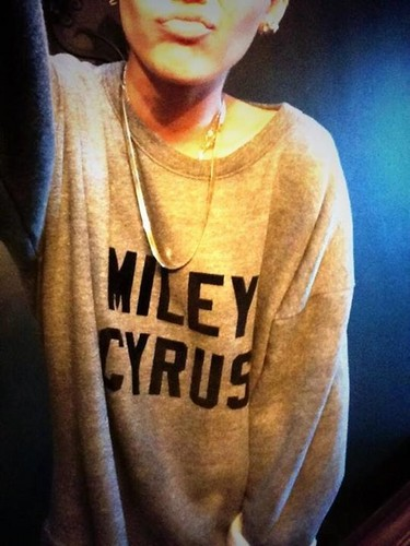 Miley wearing her own named t-shirt
