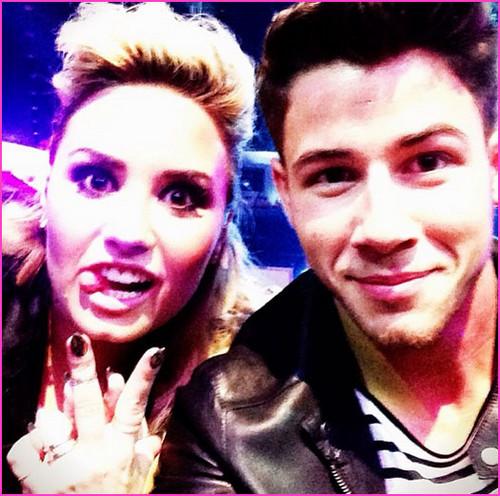 Nick Jonas And Demi Lovato At TCa 2013