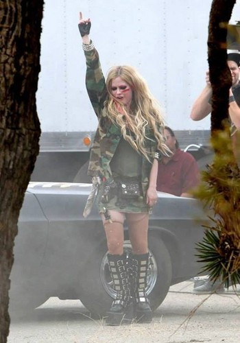 Avril Lavigne wallpaper possibly containing a hip boot entitled Rock N Roll Music Video