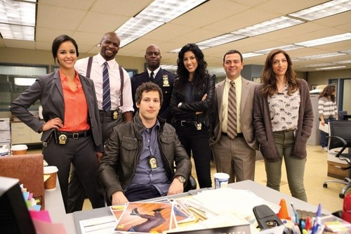 Brooklyn Nine-Nine Hintergrund with a business suit titled The Cast