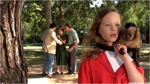 "Thora Birch achtergrond probably containing a live oak and an outerwear entitled ""Monkey Trouble"" - 1994"