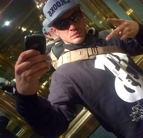 Tom Wearing 'Rum Knuckles, Dollar Gun' sweatshirt