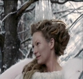 Jadis asks Edmund to sit with her.