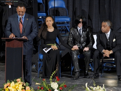 Michael Jackson, center, sits with