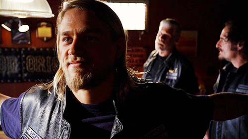 "Jackson ""JAX"" Teller वॉलपेपर probably with a sign and a portrait called Jax"