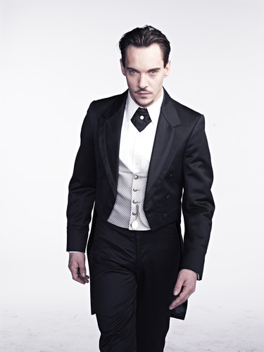 Dracula NBC wolpeyper with a business suit, a suit, and a well dressed person called Jonathan Rhys Meyers as Dracula