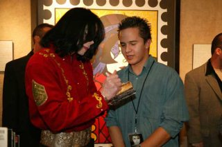 Signing An Autograph For A Fan