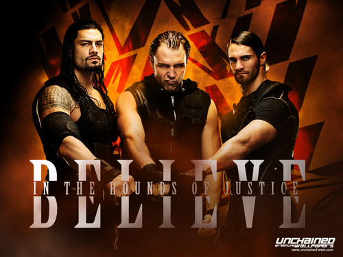WWE Hintergrund possibly containing a boardroom, a concert, and a sign entitled The Shield - Believe in the Hounds of Justice