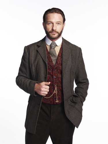 Dracula NBC wolpeyper with a business suit and a suit titled Thomas Kretschmann as Abraham van Helsing